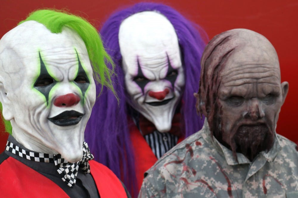 <p>Actors with makeup and costumes stand Oct. 23 at Indy Scream Park in Anderson, Indiana. The park features five different types of haunted houses, plus a separate midway area.</p>