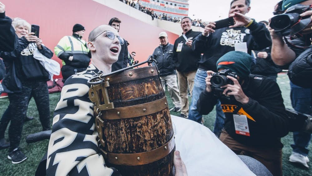 Tyler Trent holds the Old Oaken Bucket after Purdue won 28-21 Nov. 24, 2018, at Memorial Stadium. Trent attended many Purdue games while battling terminal cancer.