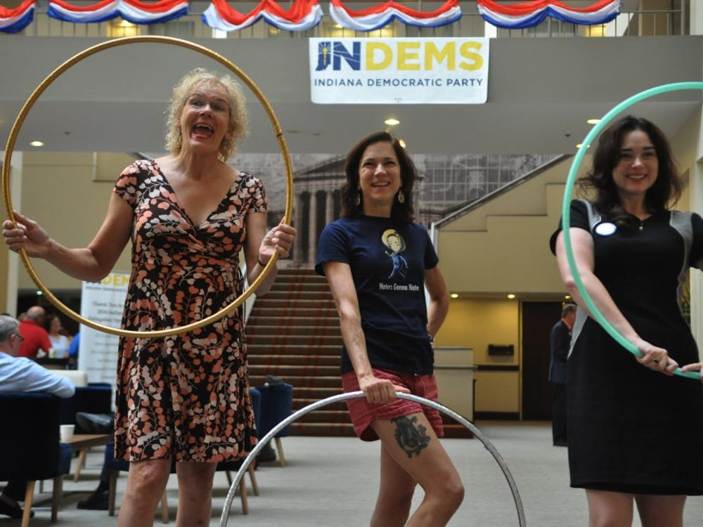 Three Indiana District 9 delegates practice with their hula hoops in the lobby of their hotel the week of the Democratic National Convention.