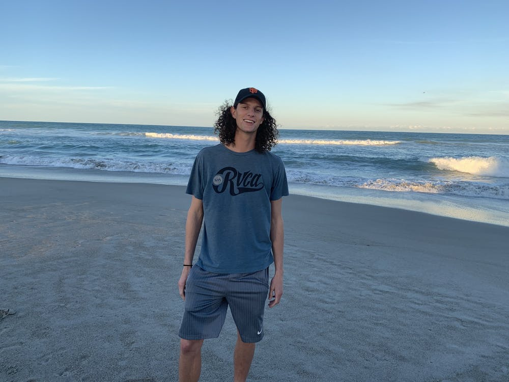 Sophomore Gerrin Moore poses for a photo on the beach in Melbourne, Florida. Moore tested positive for COVID-19 after spending spring break in Fort Lauderdale, Florida.