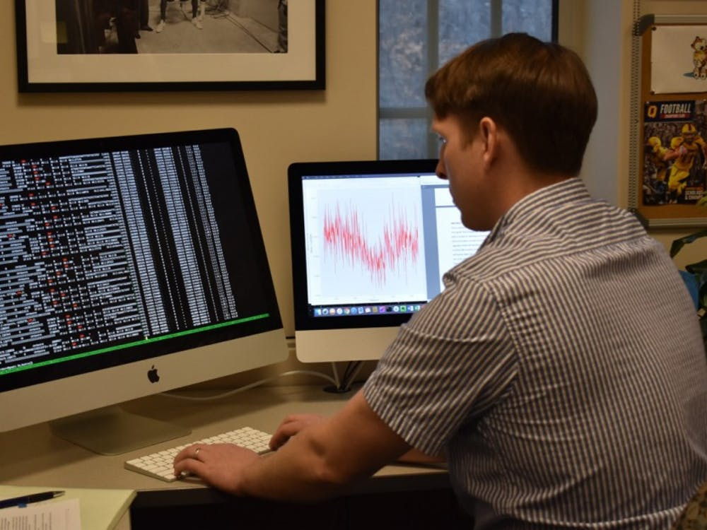 Bioinformatics scientist Taylor Raborn analyzes data at his computer. This research on plant biology provides solutions for global hunger and malnutrition.