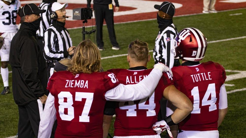 Then-senior defensive lineman Michael Ziemba puts his arm around then-redshirt junior linebacker Thomas Allen with then-redshirt sophomore quarterback Jack Tuttle on Oct. 24, 2020, in Memorial Stadium. Indiana kicks off against Michigan State at noon.