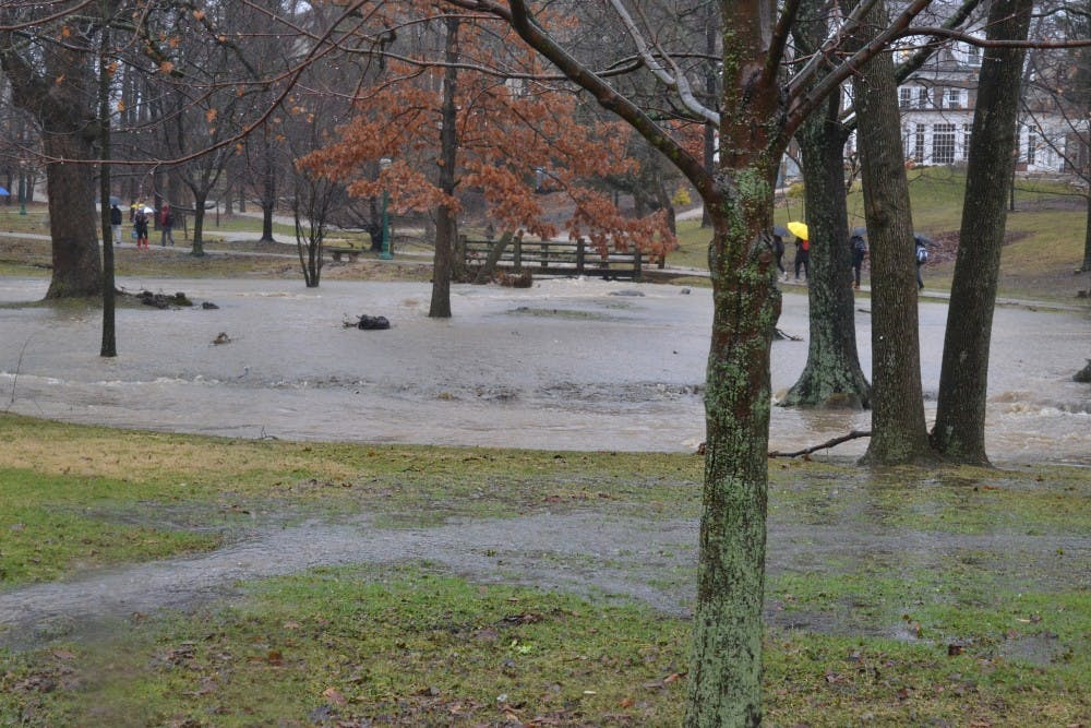 <p>The Campus River spills over its banks Feb. 7 near Woodburn Hall. Bloomington will likely receive severe thunderstorms Monday night, according to the National Weather Service.</p>