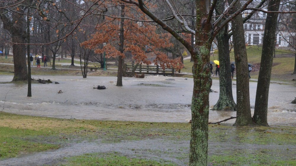The Campus River spills over its banks Feb. 7 near Woodburn Hall. Bloomington will likely receive severe thunderstorms Monday night, according to the National Weather Service.