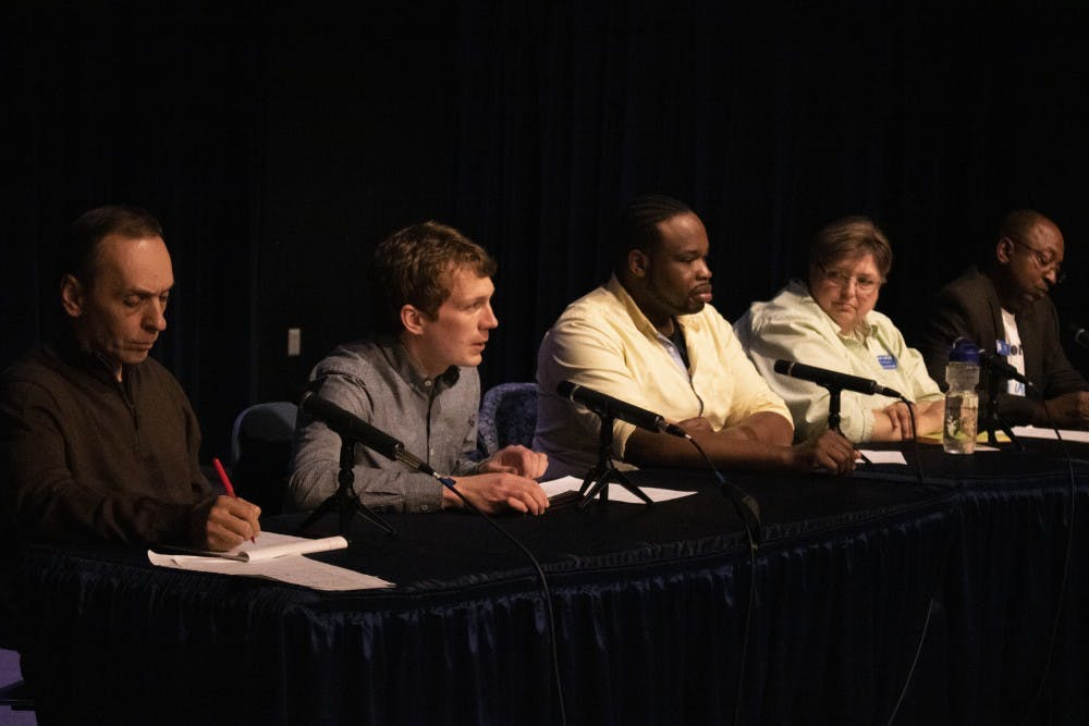 <p>City Council at-Large candidates speak to Bloomington residents at an open forum March 25 at the Monroe Public Library Auditorium. The forum, organized by the political action committee Democracy for Monroe County, allowed the candidates to elaborate on their campaign platforms. </p>