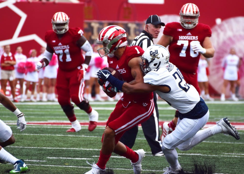 <p>Junior wide receiver Simmie Cobbs Jr. attempts to run the ball before being tackled by Charleston Southern during the Oct. 7 game at Memorial Stadium. Cobbs was one of 11 Hoosiers that have agreed to an NFL deal this offseason.</p>