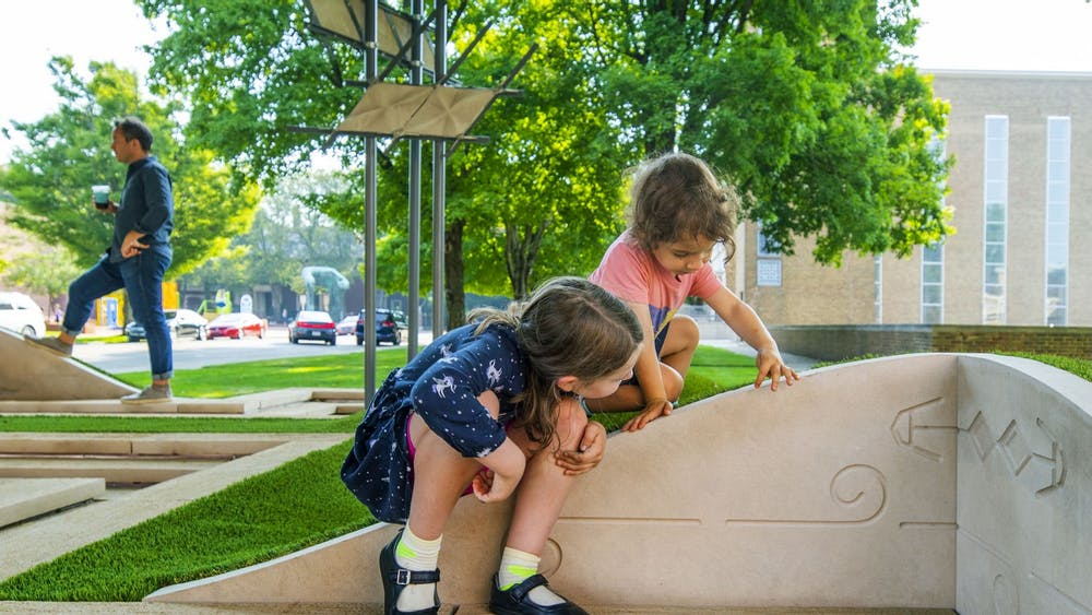 """Children play on Jei Jeeyea Kim's interactive artwork titled """"LaWaSo Ground."""" The installation became accessible to the public in August 2021."""