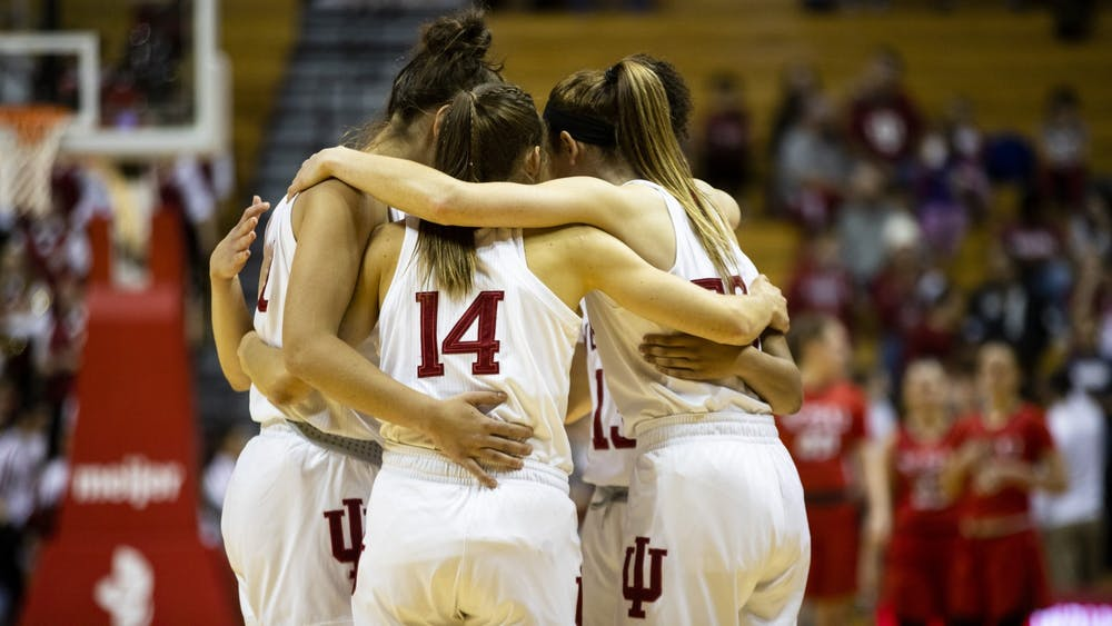 IU women's basketball huddles up before their game Dec. 15 at Simon Skjodt Assembly Hall. IU lost Jan. 20 on the road to Maryland 62-76.