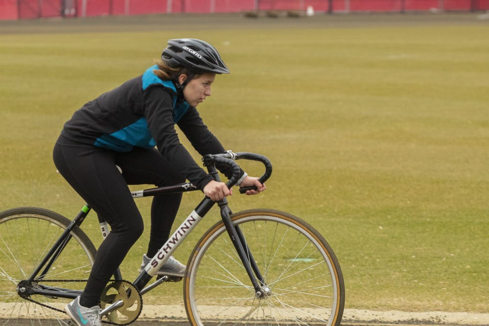 <p>Freshman Bret King rides during training for Little 500 on March 14 at Bill Armstrong Stadium. King was one of five freshman training on the women&#x27;s Army ROTC Little 500 team.</p>