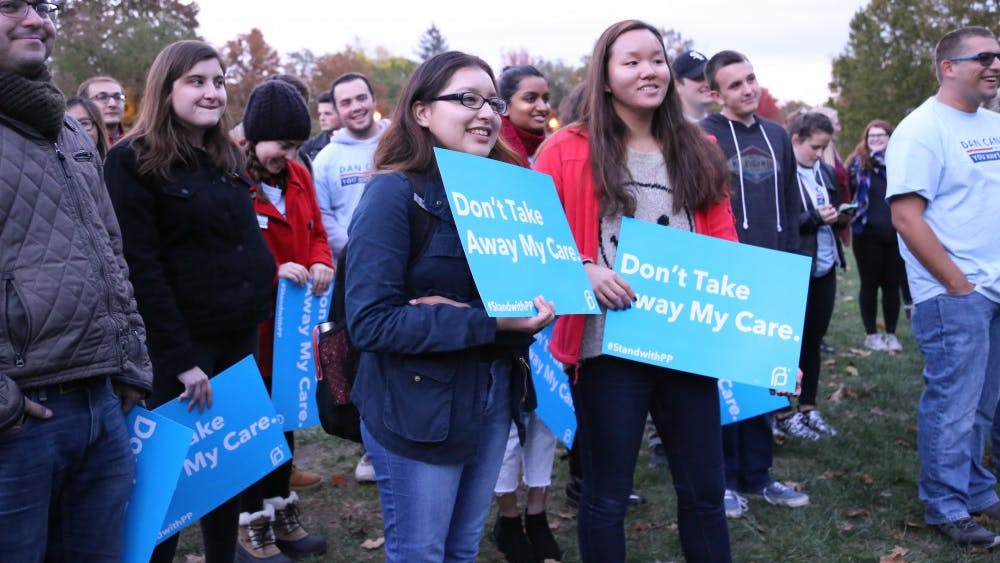 IU Democrats at IU participate in the Reproductive Rights Rally Wednesday evening. Participants rallied in Dunn Meadow to listen to speeches about reproductive rights.