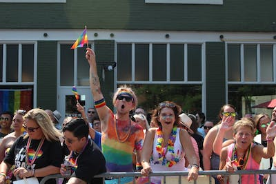 Attendees of the Indianapolis Pride Parade cheer as companies walk down Massachusetts Ave. Thousands of people made their way to Indianapolis on June 9 to support the LGBTQ+ community.