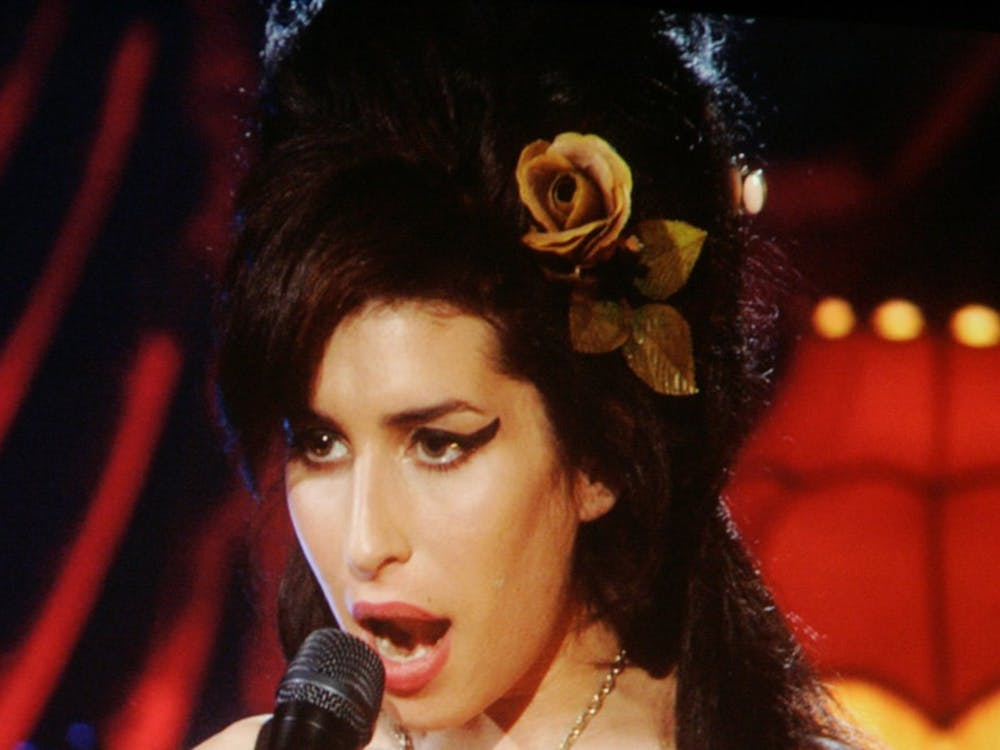 Amy Winehouse performing via telecast from the United Kingdom during the 50th Annual Grammy Awards in February of 2008. The 27-year-old was found dead in London Saturday. (Lawrence K. Ho/Los Angeles Times/MCT)