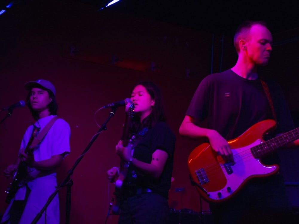 Guitarist Christian Wright, singer Hana Vu and bassist Sebastian Jones performed at the Bishop Bar Sunday evening. Eighteen-year-old Vu played a pearl white guitar with a slate blue fretboard, opening for SALES.