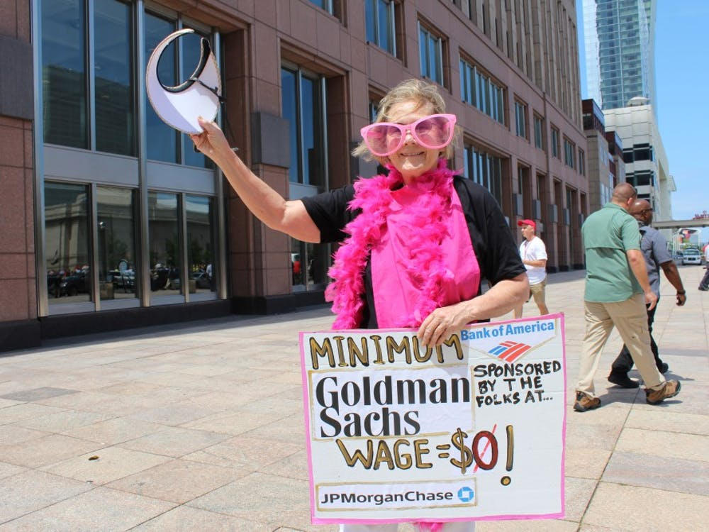 "Ann Wright, 70, is protesting with Code Pink: Women for Peace and Veterans for Peace in Cleveland at the Republican National Convention. Wright, however, said she is with ""Billionaires for Trump,"" and aims to send a satirical message referencing big banks and corporate America's role in political campaigns."