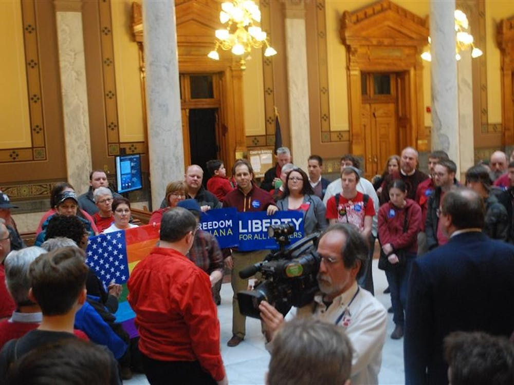 Activists from Freedom Indiana gather on the fourth floor of the Statehouse in Indianapolis after the Senate approved House Joint Resolution 3. The Indiana Senate voted 32-17 in favor of HJR3, a proposed amendment to the Indiana Constitution.