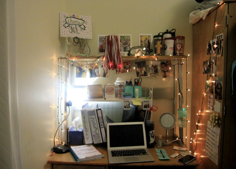 "Despite having a small work space, freshman Brooklynn Weisenbach makes the most of it and decorates with photos and Christmas lights. ""I only study in my dorm,"" Weisenbach said. ""It's easy for me to differentiate schoolwork and relaxing time even when working in my room."""