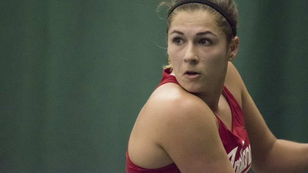 Then-junior, now-senior Natalie Whalen eyes a backhand during her 3-6, 4-6 singles loss to Purdue in 21u.