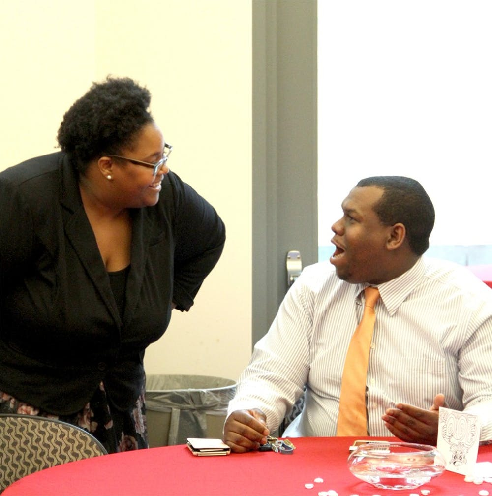 Monica Green, a new director of the Neal Marshall Cultural Center talks with her future husband, Michael Johnson  Wednesday at the Neal Marshall New Director Meet and Greet.