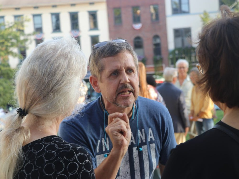Dave Majercak Sr. argues with Rabbi Sue Silberberg after the Bloomington United event Aug. 27, outside the Monroe County Courthouse. He interrupted her speech earlier in the evening.