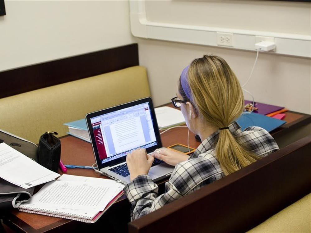 Then-freshman Madeline Ehrlich studies for finals and works on a paper Dec. 4, 2011in the Wells Library.
