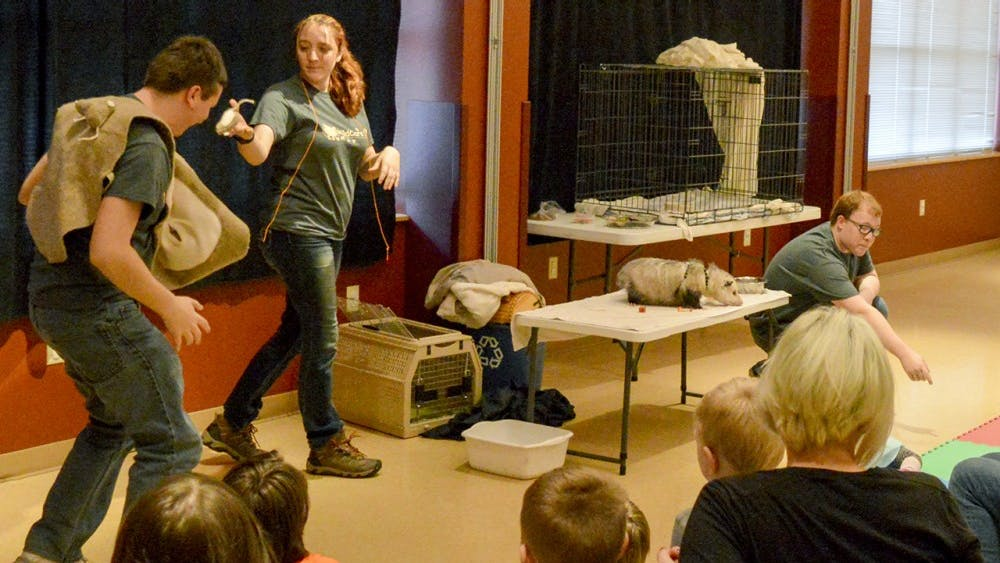 """Bloomington families and watch as a live demonstration is given on how a possum manages to play dead during WildCare Inc's """"Science Live: Smart Animals"""" Thursday March 24, 2016 at the Wonderlab. Jennifer Jenkins, the museum's visitor services manager, recently received the Lt. Governor's Hoosier Hospitality Award for her work in the tourism field. Wonderlab has welcomed visitors from all but two counties in Indiana."""