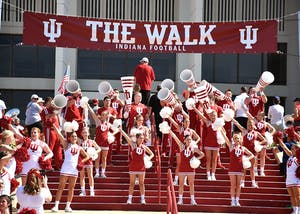 "IU cheerleaders cheer during ""The Walk"" prior to IU's football game against Georgia Southern on Sept. 23. ""The Walk"" is one of the top game day traditions enjoyed by IU football fans."