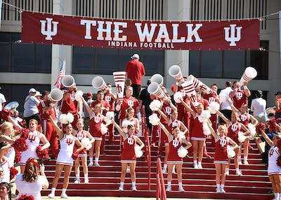 """IU cheerleaders cheer during """"The Walk"""" prior to IU's football game against Georgia Southern on Sept. 23. """"The Walk"""" is one of the top game day traditions enjoyed by IU football fans."""