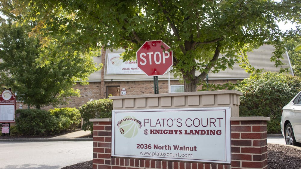 The sign for Plato's Court is pictured Sept. 10 in front of the apartment complex at 2036 N. Walnut St.