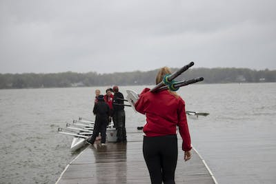 Rowers prepare their boats April 20 at Dale England Rowing Center on Lake Lemon. IU won with 72 points in the 11th annual Dale England Cup against the University of Notre Dame and Michigan State.
