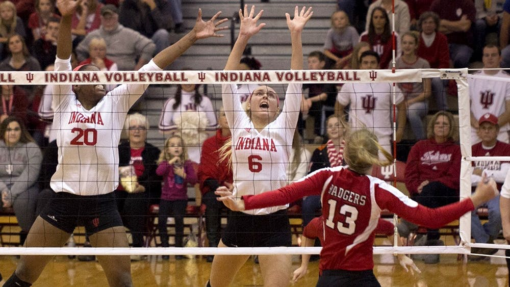 Sophomore Taylor Lebo goes up to block a spike during IU's match against Wisconsin on Saturday at University Gym. The Hoosiers lost 3-0 to the Badgers.