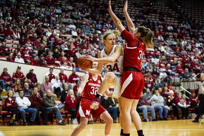 Sophomore Grace Berger passes the ball while under the basket Feb. 27 in Simon Skjodt Assembly Hall. Berger scored 15 of IU's 81 points against Nebraska.