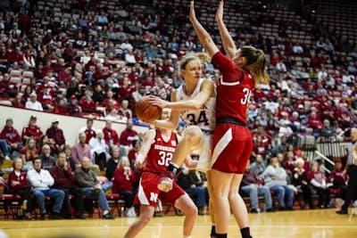 Sophomore Grace Berger passes the ball while under the basket Feb. 27 in Simon Skjodt Assembly Hall. Berger scored 15 of IU's 81 points against Nebraska.