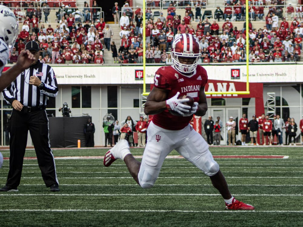 Graduate running back Stephen Carr rushes against Michigan State on Oct. 16, 2021, at Memorial Stadium. Indiana lost to Michigan State 20-15.
