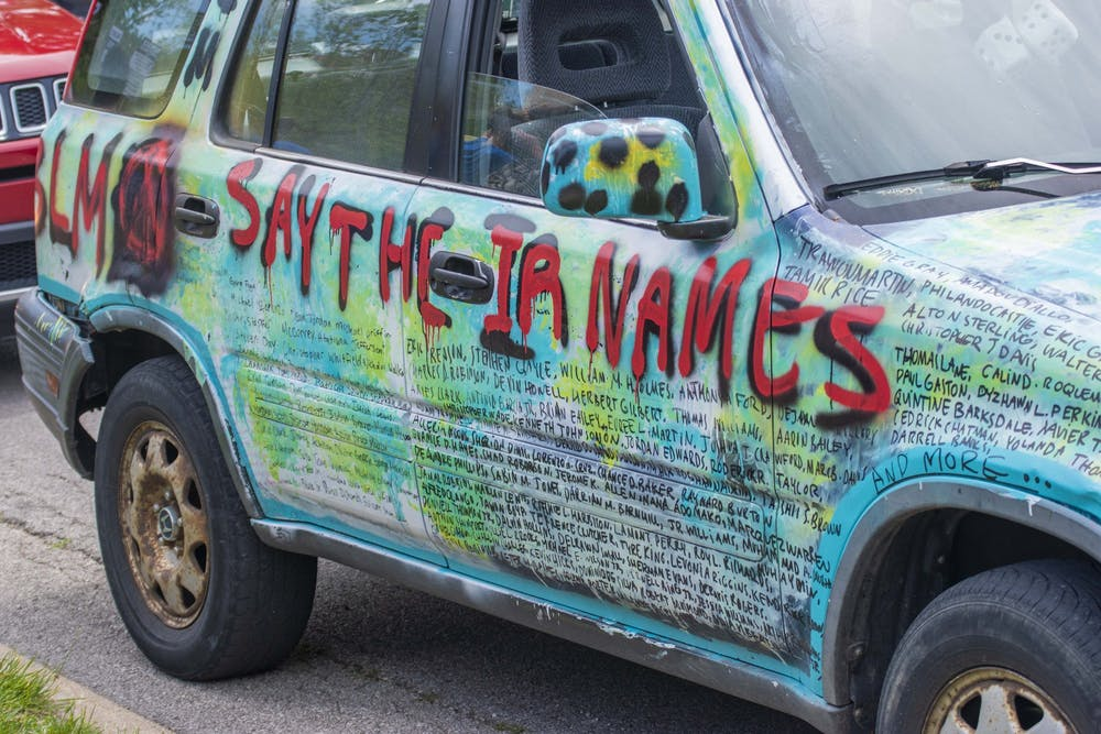 <p>A Honda CR-V decorated with Black Lives Matter slogans is parked June 5 next to Dunn Meadow. A few other cars were decorated similarly, and many protesters at the June 5 'Enough is Enough' protest held up signs they had decorated themselves.</p>