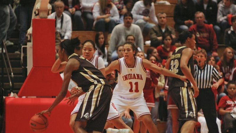 Senior Forward Whitney Thomas and Senior Guard/Forward Kim Roberson successfully prevent a Purdue offensive player from making a basket. After a very close first half, the Hoosiers won 71-57 against the Boilermakers Monday evening at Assembly Hall.