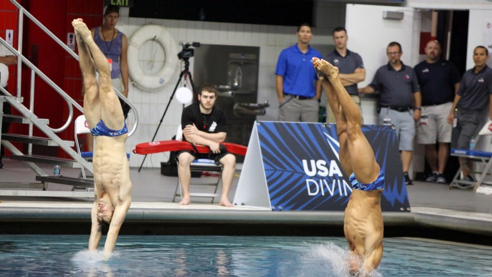 Michael Hixon, left, and Samuel Dorman, right, dive during the men's synchronized 3-meter  springboard preliminaries at the 2016 U.S. Olympic Team Trials in Indianapolis Saturday.