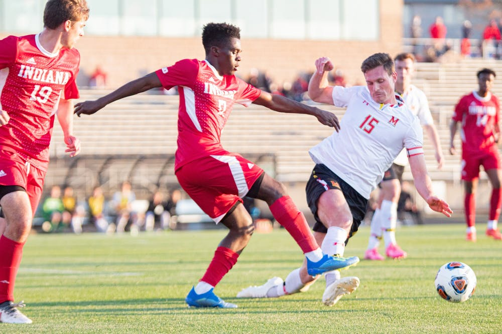 <p>Sophomore forward Herbert Endeley fights for the ball against Maryland on April 14 in Bloomington. IU men&#x27;s soccer defeated Marquette University 2-1 Thursday in Cary, North Carolina to advance to the Elite Eight of the NCAA Tournament.</p>
