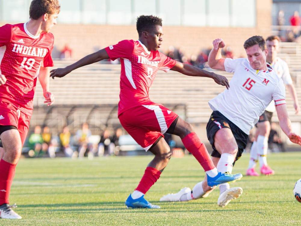 Sophomore forward Herbert Endeley fights for the ball against Maryland on April 14 in Bloomington. IU men's soccer defeated Marquette University 2-1 Thursday in Cary, North Carolina to advance to the Elite Eight of the NCAA Tournament.