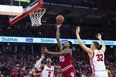 Senior forward De'Ron Davis shoots the ball during the second half of the game Dec. 7 at the Kohl Center in Madison, Wisconsin. IU men's basketball travels to New York City on Tuesday to play the University of Connecticut at Madison Square Garden.