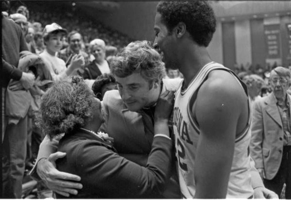<p>Former IU basketball player Mike Woodson celebrates with his mother and former IU basketball coach Bob Knight after a game in 1980 at Ohio State. IU hired Woodson to be the new men&#x27;s basketball coach Sunday.</p>