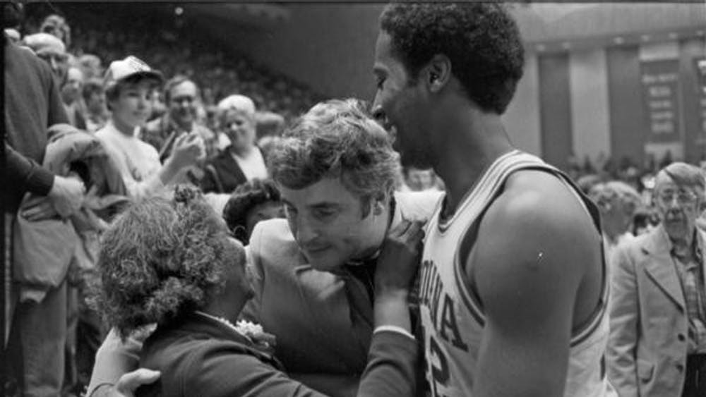 Former IU basketball player Mike Woodson celebrates with his mother and former IU basketball coach Bob Knight after a game in 1980 at Ohio State. IU hired Woodson to be the new men's basketball coach Sunday.