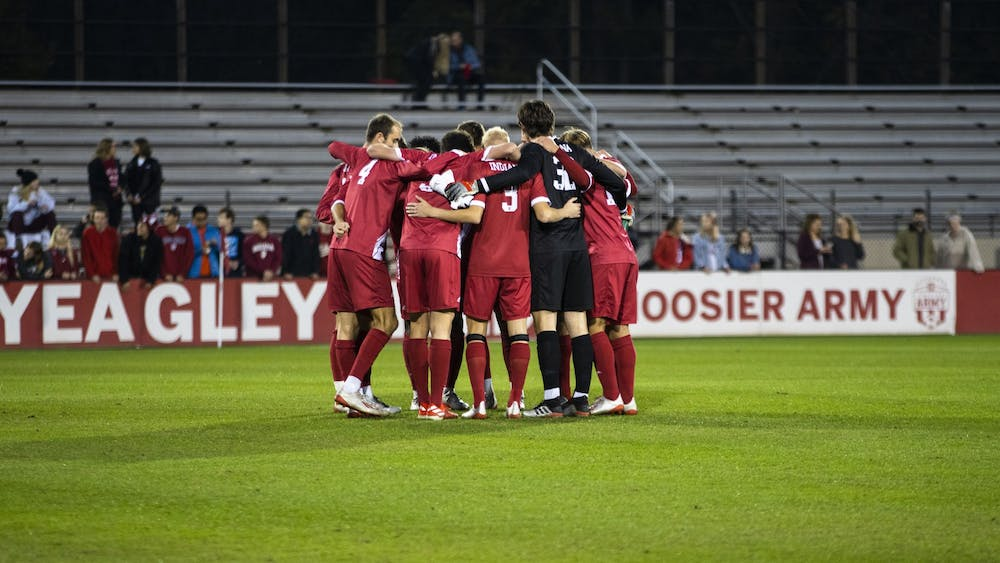 IU men's soccer team huddles together before its match Oct. 25 at Bill Armstrong Stadium. IU will play at Michigan State on Sundayand will clinch the Big Ten Title with a win.