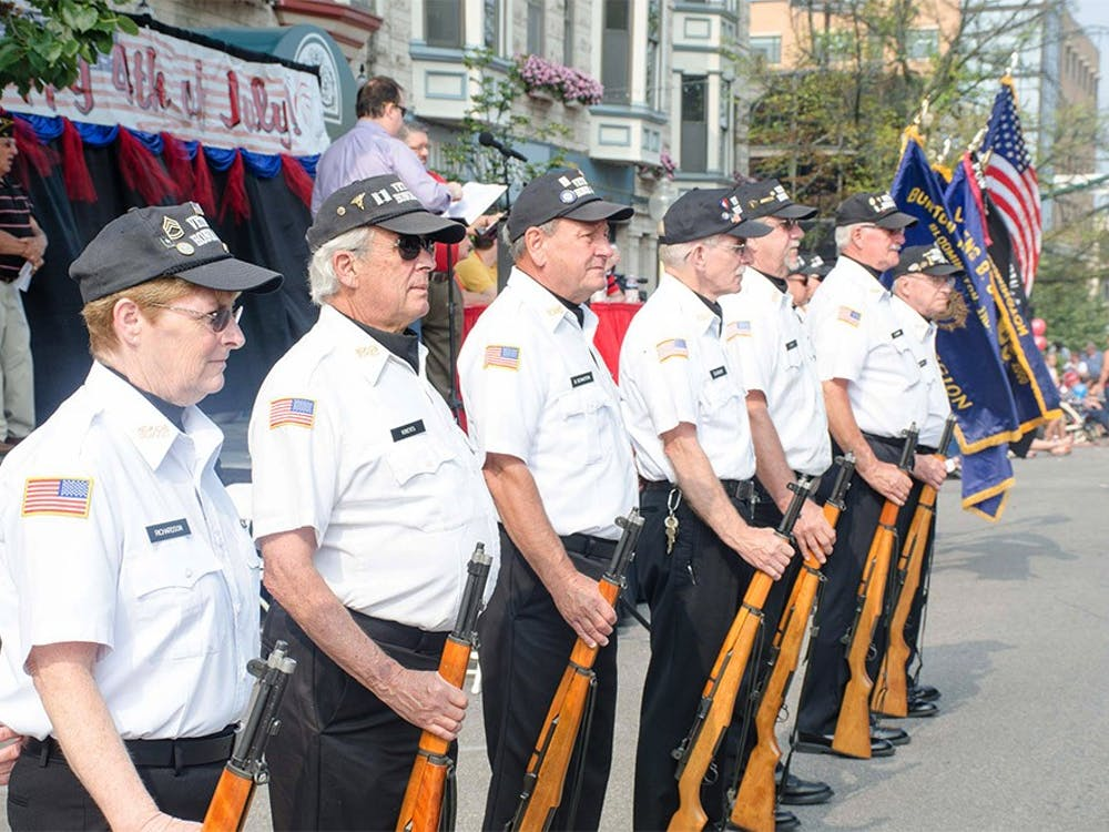 Veterans of The American Legion Burton Woolery Post 18 stand on Kirkwood Avenue which the Fourth of July Parade would pass on Saturday. The Parade is hosted by Bloomington Parks and Recreation and Downtown Bloomington, Inc. and is sponsored by The American Legion Burton Woolery Post 18.