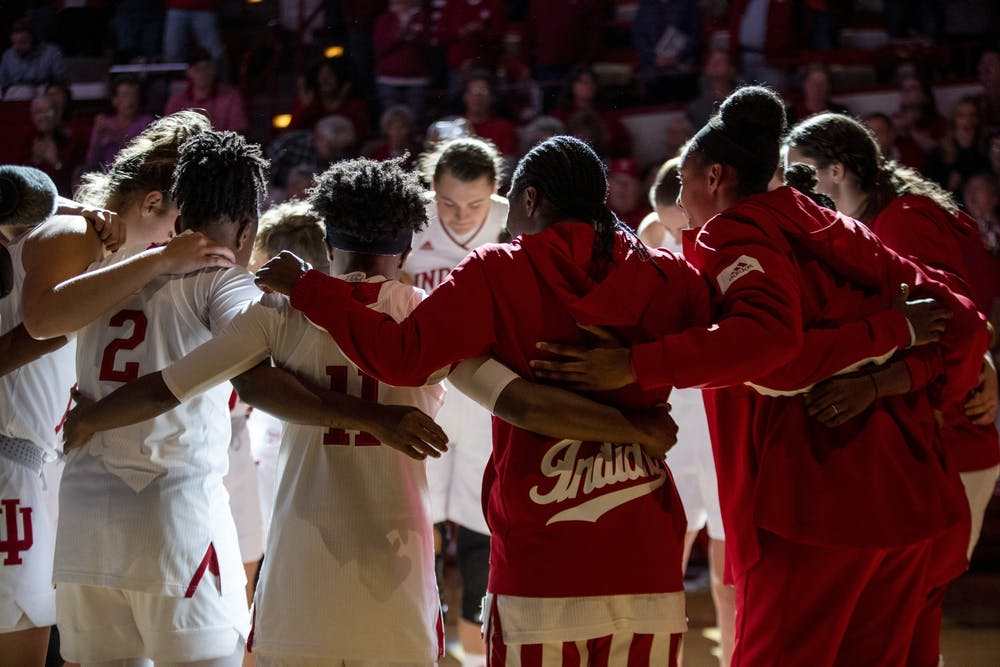 <p>The IU women's basketball team huddles together before their match against Mount St. Mary's University on Nov. 7 at Simon Skjodt Assembly Hall. IU won their first match of the season, 75-52. </p>