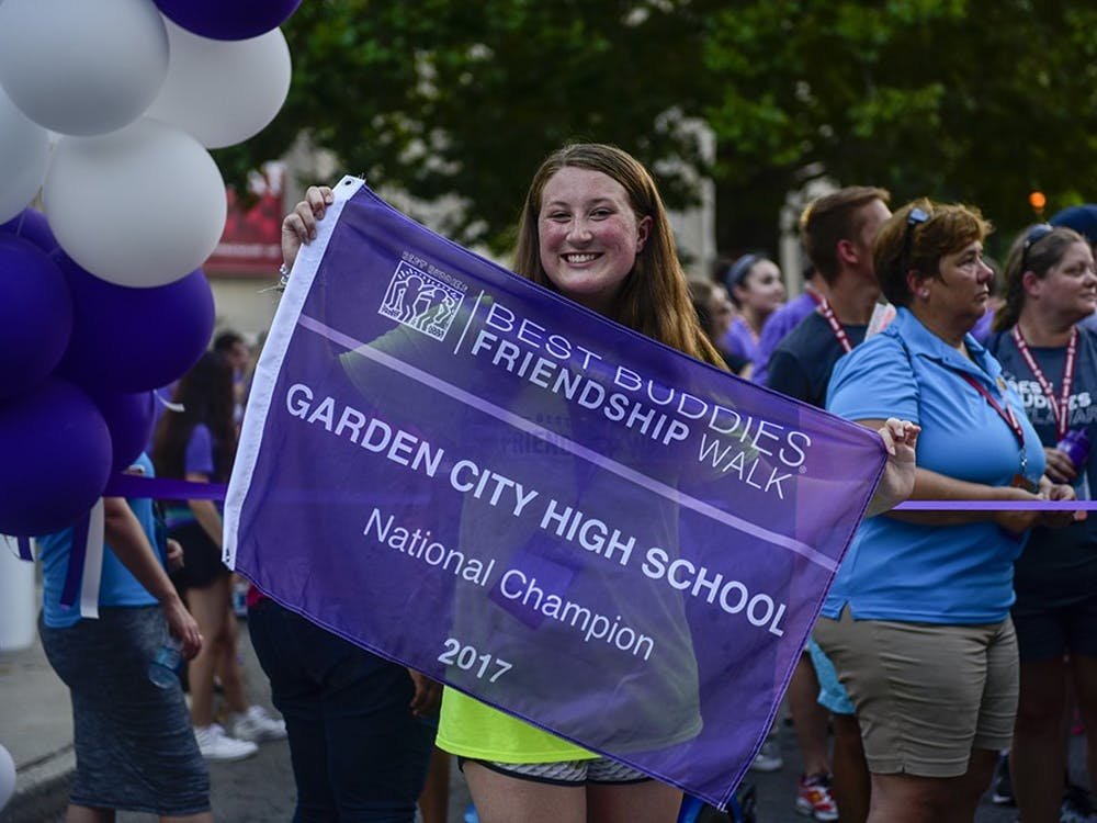 Michaela McGovern, leader of Best Buddies at Garden City High School, leads the friendship walk. Garden City High School have increased the fundraising for Best Buddies each of the last four years.