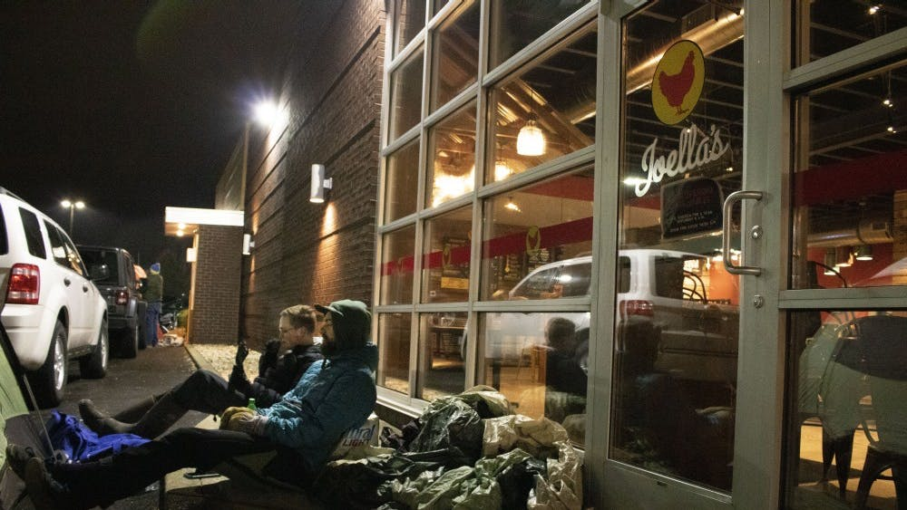 Jake Kelley and Michael Partridge wait outside the new Joella's Hot Chicken location Jan. 23 at 3002 E. Third St. The two planned on camping out until the next morning in hopes of obtaining free chicken for an entire year.