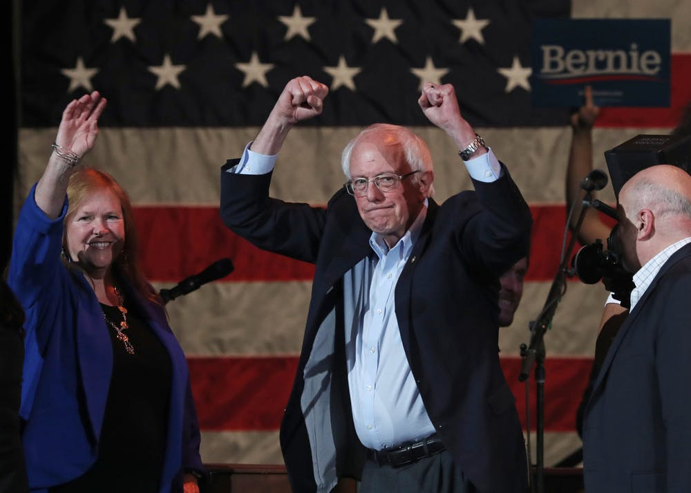 <p>Presidential candidate Sen. Bernie Sanders and his wife, Jane, acknowledge supporters after speaking at a campaign event Feb. 1 in Cedar Rapids, Iowa, at the U.S. Cellular Center.</p>