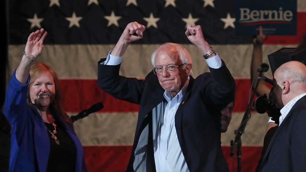 Presidential candidate Sen. Bernie Sanders and his wife, Jane, acknowledge supporters after speaking at a campaign event Feb. 1 in Cedar Rapids, Iowa, at the U.S. Cellular Center.