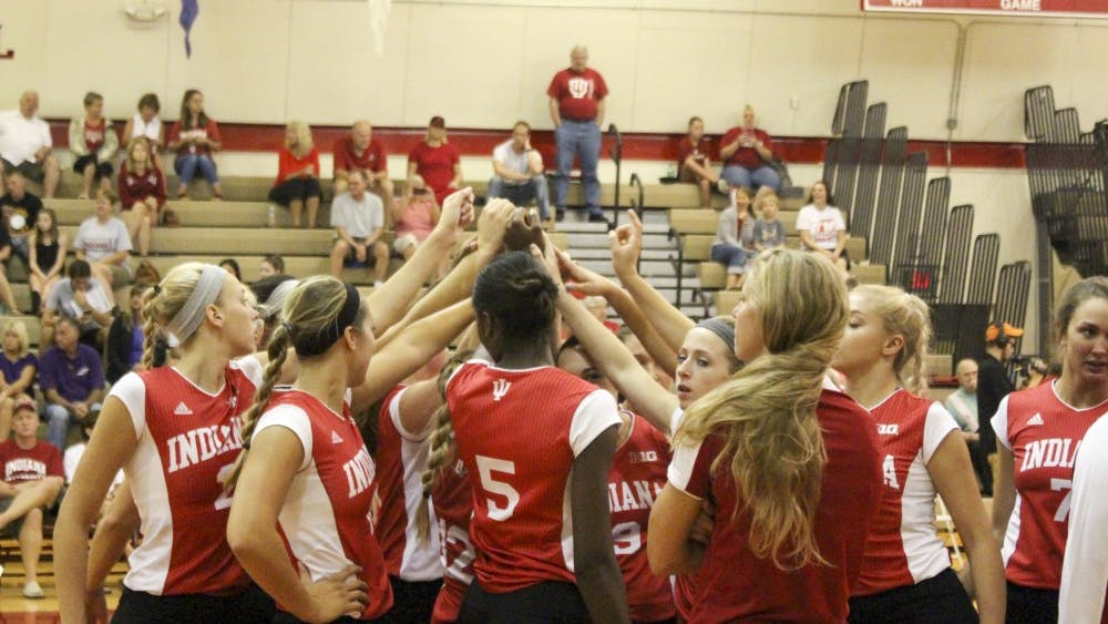 The team gathers during a time out during game two, as they are only points away from winning during the IU Volleyball game against Evansville Saturday afternoon at University Gym.