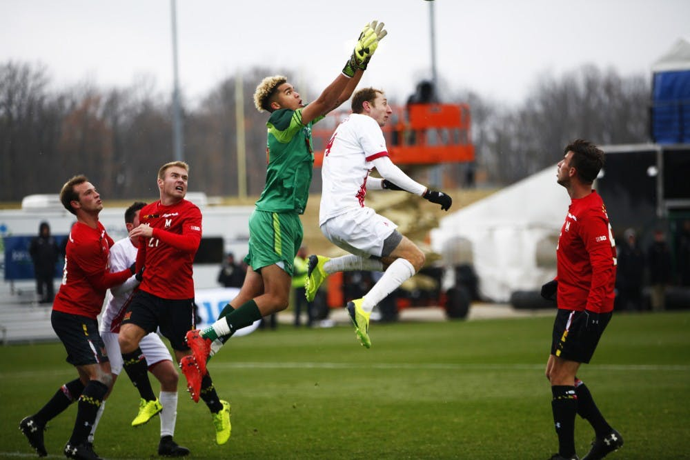 <p>Sophmore A.J. Palazzolo and Maryland junior goalkeeper Dayne St. Clair go for the ball Nov. 9 at Grand Park during the Big Ten men's soccer tournament. Palazzolo has scored four goals throughout the season.&nbsp;</p>